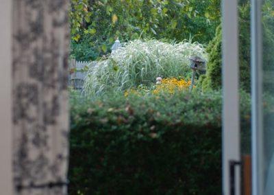 Garden Room Window plants view | Brewster By the Sea Cape Cod B&B | Brewster, MA