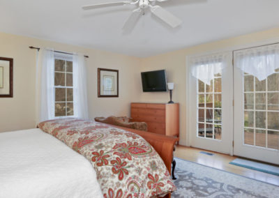Refugio Suite Bedroom with TV | Brewster By the Sea Cape Cod B&B | Brewster, MA