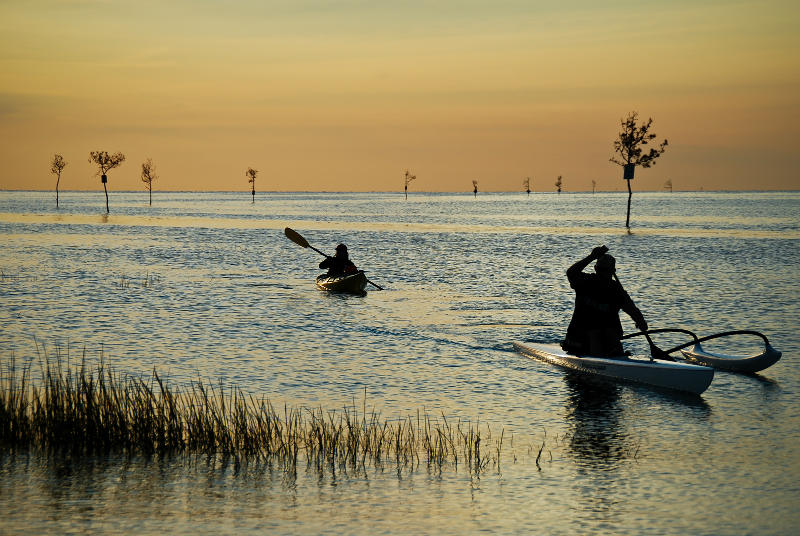Two people kayaking by Rock Harbor in Orleans at sunset | Brewster By the Sea Cape Cod Inn | Brewster, MA