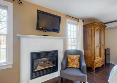 Beach Blossom Fireplace | Brewster By the Sea Cape Cod B&B | Brewster, MA